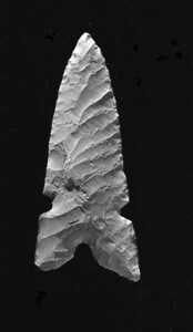 McKean complex projectile point from Wyoming.  It is coated with amonium chloride smoke to bring out the flaking patterns.