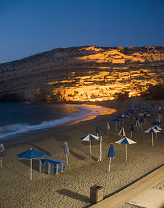 Ancient Roman tombs in the cliffs at Matala on the southern shore of Crete. Lit up at night.