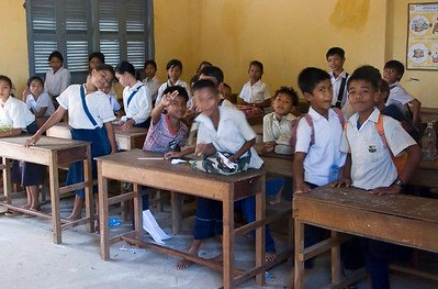The village school, with students. Children attend school for a half day, and there are two shifts per day.