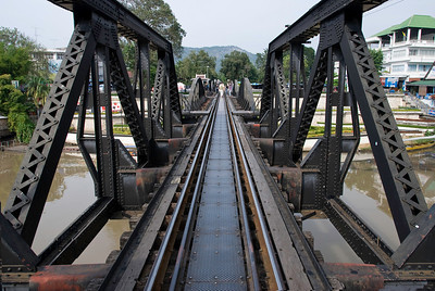 Bridge on the River Kwai.  Tourists are allowed to stroll on it, even though it is still used for actual train traffic.
