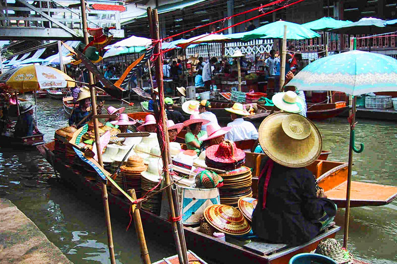 A busy and packed river traffic of the floating market.