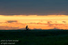 October - A bike rider outlined against the sunset sky