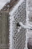 February - A fence post covered with frost
