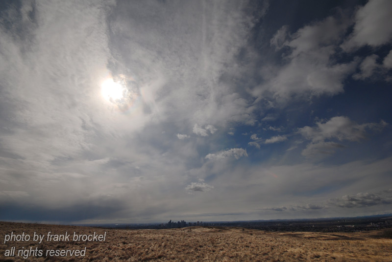 April - A super wide angle scenic of Nose Hill, the sky and downtown Calgry on the skyline in the centre
