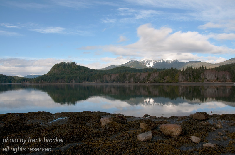 "Skidegate Channel, which divides Graham Island (north) from Moresby Island (south) as seen from the shore west of Queen Charlotte City harbour.  The mountain they call ""Sleeping Beauty"" in the background."