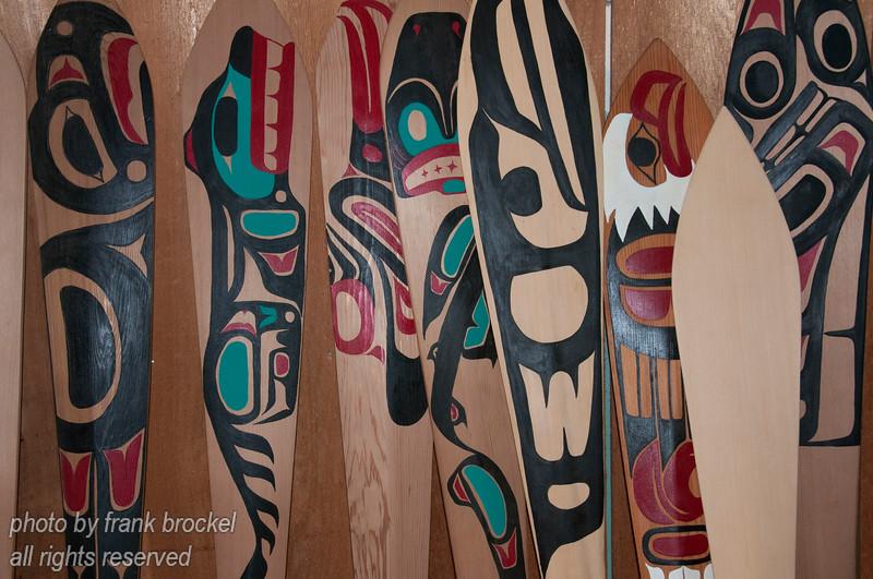 Paddles arraged against a wall at Haida Heritage Centre at Kaay Llnagaay