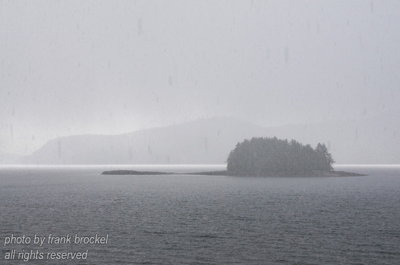 Islands in the mist ... or in this case a small island in the Skidegate channel disappearing in a snow squall.