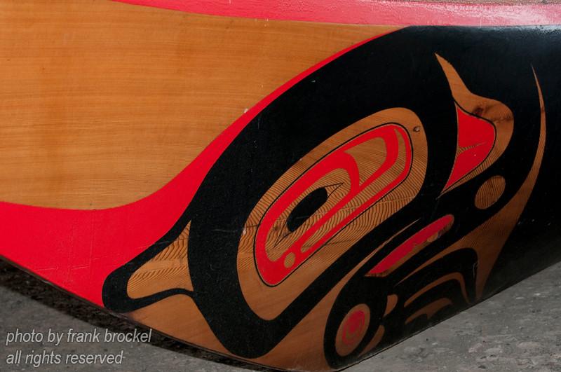 The bow of a canoe at haida gwaii,queen charlotte,skidegate,totem pole,haida art,ocean,pacific