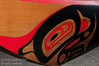 The bow of a canoe at haida gwaii,queen charlotte,skidegate,totem pole,haida art,ocean,pacific