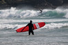 Surfers braving the frigid Pacific Ocean at Long Beach on the west coast of Vancouver Island in late March
