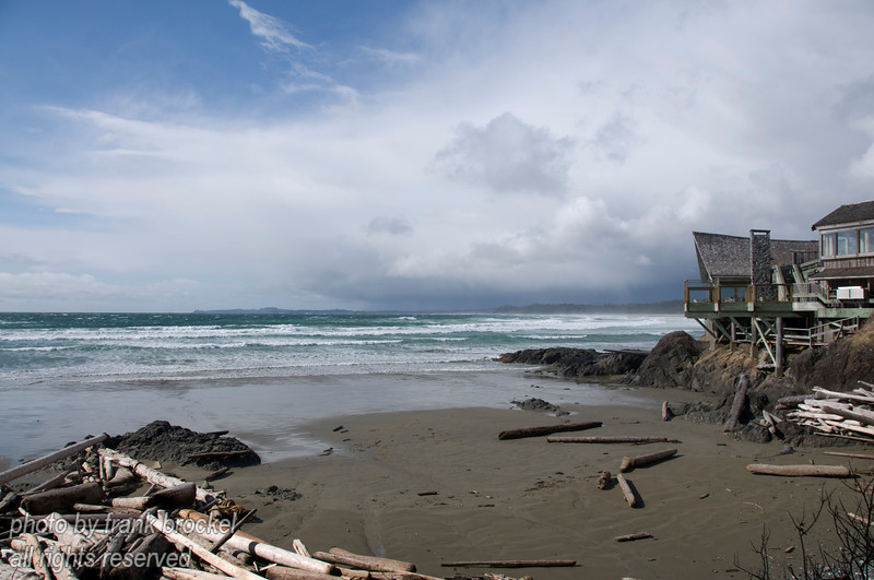 The coast at Wickaninnish Beach on the west coast of Vancouver Island with the Wickaninnish Interpretive Centre at right
