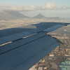 Cape Town landing views : Well there is not much I can say but this is what you are most likely will see if you are landing in Cape Town and have a window seat. Usually the planes will U turn over the sea  and than approach the runway. Don't quote me on it 100% maybe if the wind blows differently you may come down from over the land although it has never happened to me over many landings during my ten years in South Africa. I just imagine how busy it will be in 2010 when the football world championship will bring many to the new Greenside stadium that had a very controversial planning.Kulula.com airways offers very affordable flights within South Africa and many specials check it out online.