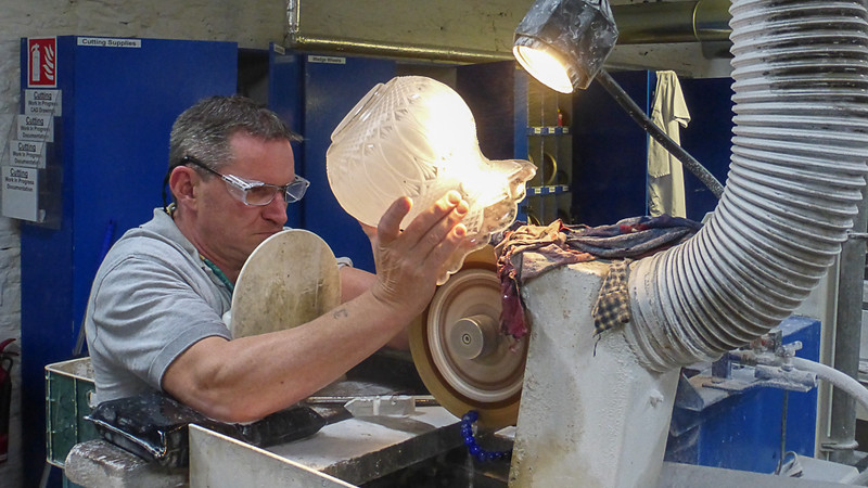 Cutting facets in a crystal vase.