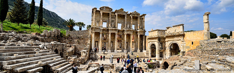 LIBRARY OF CELSUS<br /> <br /> A technological wonder, with double walls to keep out the damp and moderate the extremes of temperature, it is also perhaps the most beautiful building at Ephesus, finely restored. To the right is the Gate of Augustus, a monumental arch leading to the Commercial Agora.<br /> <br /> The Library was built in A.D. 135, after the time of Paul and John.