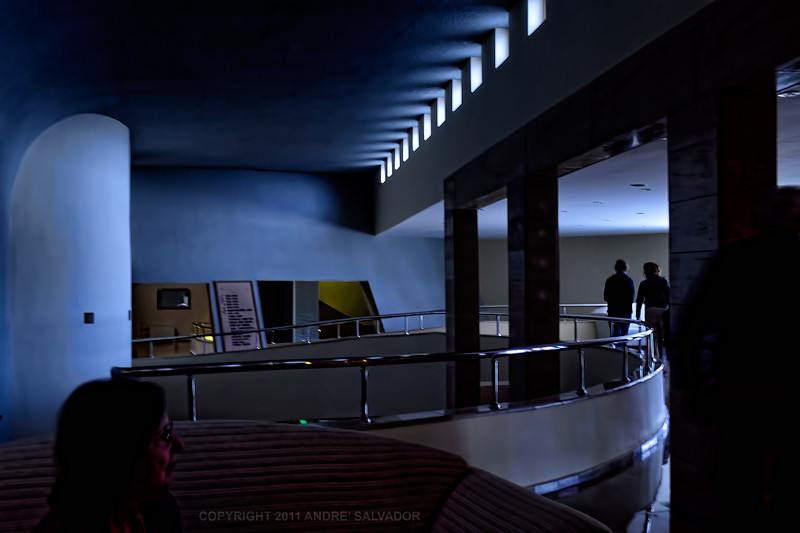 A cylindrical ramp goes down to the main lobby
