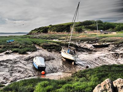 Boats in low tide mud