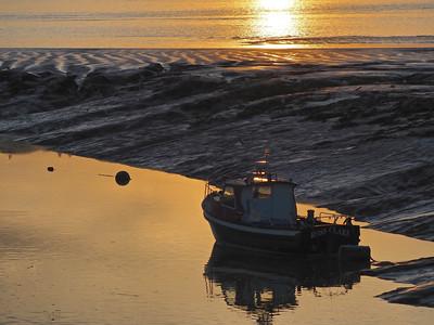 Boat in setting sun