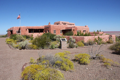 The Painted Desert Inn was constructed by the Civilian Conservation Corps in 1937–1940.  A portion of the main lodge building was remodeled from the 1920s inn on the site, and then became known as the Stone Tree House due to much local petrified wood used in its architectural elements.