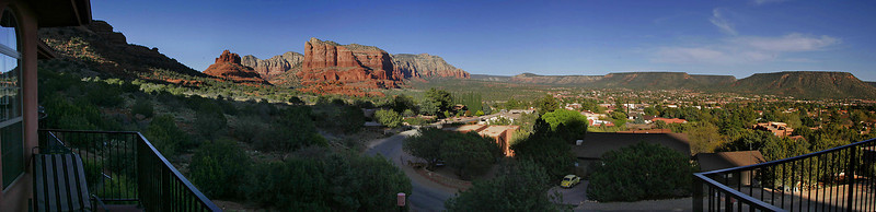 The view from our balcony over Oak Creek, with Bell Rock and Courhouse Butte on the left.  4-image panorama.
