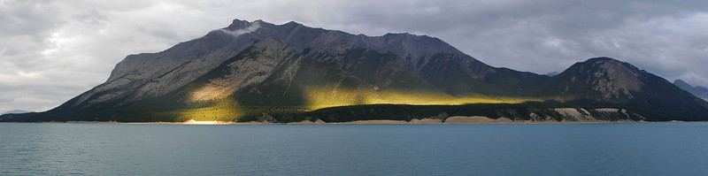 Storm and light plays over the land beyond Lake Abraham.  This is the view from our lodge on the Lake.  (4-image panorama)