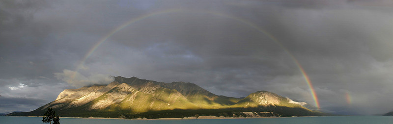 A rainbow forms over the far shore of Lake Abraham.  (3-image panorama)