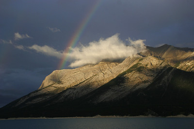 Storm, light and rainbow over Lake Abraham.