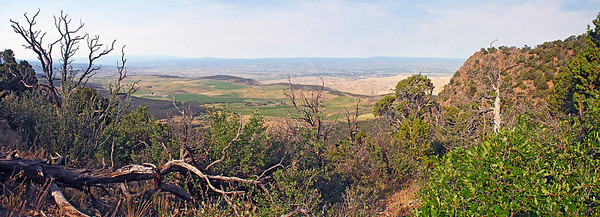View to southwest over the Uncompahgre plateau.  On the horizon, at left, are the San Juan mountains in the southwestern corner of the state which include such places as the Telluride ski resort.