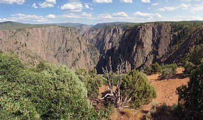 First view of the canyon, after setting up camp, happens at nearby Tomichi Point.  The canyon is carved by the 164 mile long Gunnison River which flows from the southeast, and ends up flowing into the Colorado River at Grand Junction to the northwest.