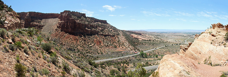 Looking back at the approach road into Colorado National Monument.  The light strip of earth (just right of center) leading up the hillside on the other side of the road is the Redlands earthquake fault.