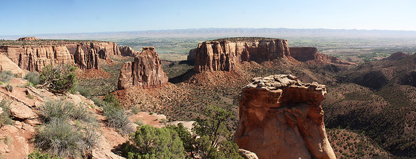 Done with the Otto Trail, we drove along Rim Rock Drive, the principle road in the park.  This is the view from the Grand View Overlook, with Independence Monument in the middle.  The nearby formation is the Kissing Couple (whose name is more obvious from a different viewpoint).