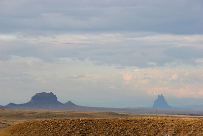 Formations to the south, including Ship Rock on the right, about 25 miles away.
