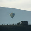 """<span style=""""color:yellow;"""">First we visited our friends Dan and Kathy Devlin at their home in Tabernash, which is high in the Rockies.  Here is a morning balloon rising out of nearby Winter Park as seen from the Devlin's back deck.  </span>"""