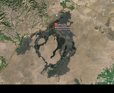 In this Google Earth Map you can see the dark scar of volcanic activity which makes this notable enough to be a national park.