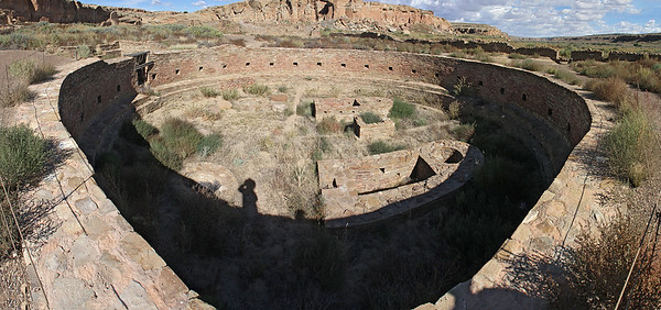 "Chetro Ketl has a large sized ""Great Kiva"" , found at only a few ruin sites in the Chacoan cultural area.  It is circular, but appears distorted in this photo due to the panorama building process in Photoshop ... this is 9 vertically oriented photos stitched side-by-side."