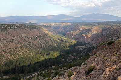 Bandelier Nat'l Monument is contained within the Frijoles Canyon.  In the background you see the Jemez Mountains above the town of Los Alamos.