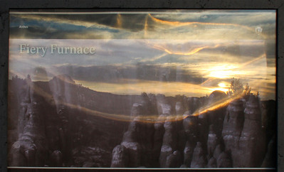 Here's a sunset reflected in a park sign about the Fiery Furnace.