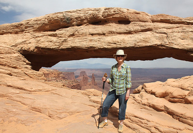 Teddie poses with Chippie (on top of her walking stick) by Mesa Arch.