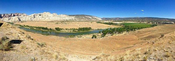 Two large rivers, the Green and the Yampa, run through park.  Shown here is the Green River as it emerges through Split Mountain (the white peak) on the southwest side of the park.  On the right, the trees by the river cover our campground.