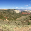 """<span style=""""color:yellow;""""> An iPhone panorama view over the Echo Park Road as it descends into Sand Canyon.  Our truck would have done well on the dirt road, but we just didn't have enough time.  </span>"""