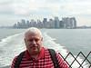 Tom aboard the Staten Island Ferry, lower Manhattan in the background