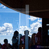"A reflection on the mirror of the Visitors Center where we lined up to buy tickets for the tour of Balcony House. When we bought the tickets it was noted on a signage and we were informed verbally that those afraid of heights and with heart problems should be aware that the tour will go down mountain trails and stairs, then go up to the dwelling location and acess 3 separate wood ladders of 8'-0"" high, 20'-0"" high and 33'-0"" high. Aside from that, a full size model of  hole or rock opening is shown on the deck outside. Visitors were told that they will be going through a rock tunnel that size."