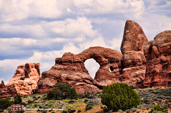 The South Window on a rock wall from afar. The Windows group attracts a lot of people because in this one area are many arches and you do not have to walk far to see them all.