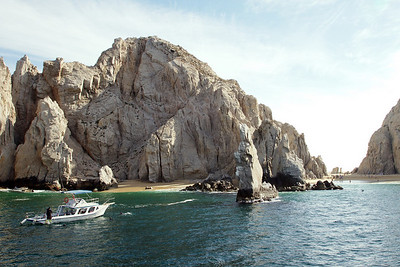 "This is the famous ""Love Beach"" at Cabo. And on the other side of the rocks where the waves are brutal, ""Divorce Beach""."