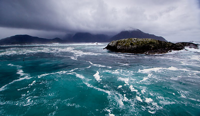 Exiting the mouth of the Doubtful Sound into a stormy Tasman Sea aboard a small ship. This was an incredible moment...turbulent, wet, and jaw-droppingly beautiful. I could barely stand upright long enough to capture this image