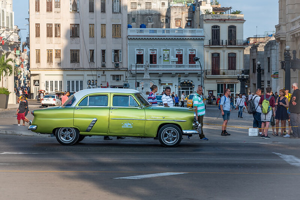 Taxis and drivers ready for the evening in Havana, Cuba.