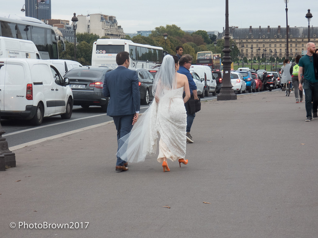 Bride And Groom Cross Bridge