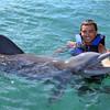 Happy man swim with dolphin