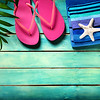 Beach accessories on wooden - summer background