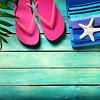 Beach accessories on wooden - summer background