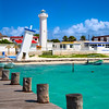 old tilted and new lighthouses in Puerto Morelos, Mexico